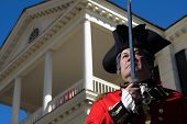 pic of revolutionary war  - Man in British military dress at Revolutionary War Re - JPG