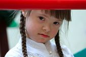 stock photo of fanny  - Fanny girl on the playground looking  - JPG