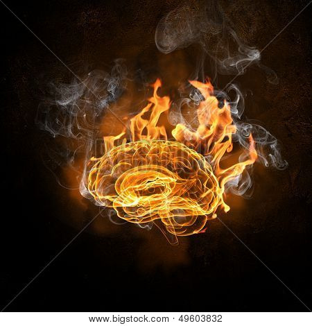 Human brain in fire flames against black background