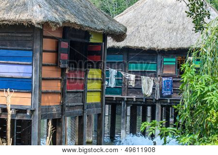 Colorful Stilt Village In Africa Floating  With Laundry.