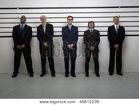 Businessmen standing in police lineup