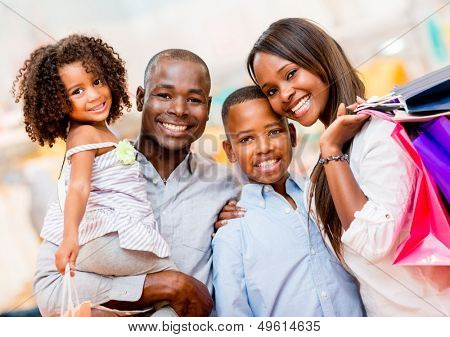 Portrait of a family shopping and looking very happy
