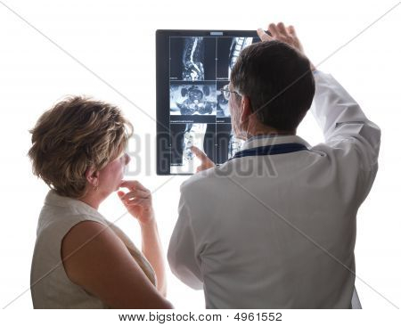Doctor Viewing Scans With Patient
