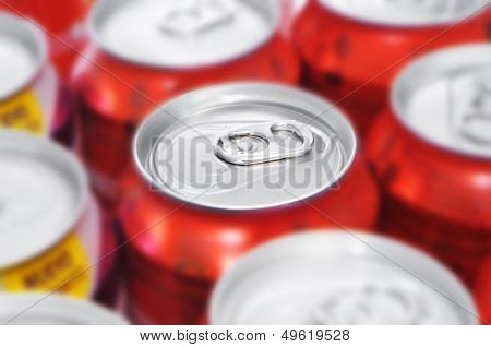 closeup of a lot of soda cans