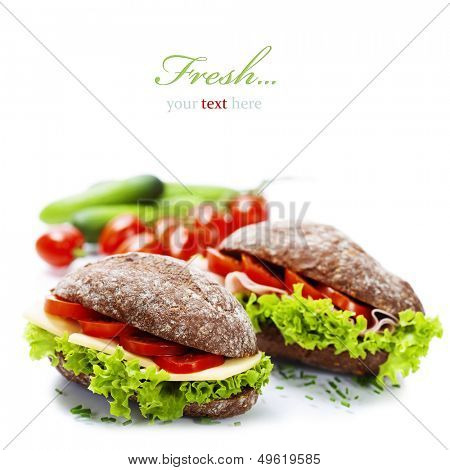 Grain bread sandwiches with ham,cheese and fresh vegetables over white - healthy eating concept (with easy removable sample text)