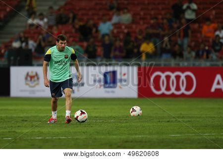 KUALA LUMPUR - AUGUST 9: FC Barcelona 's Lionel Messi practices during training at the Bukit Jalil Stadium on August 09, 2013 in Malaysia. FC Barcelona is on an Asia Tour to Malaysia.