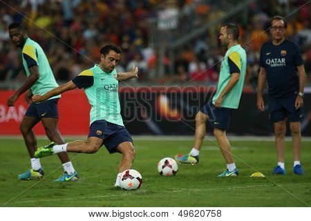 KUALA LUMPUR - AUGUST 9: FC Barcelona 's Xavi Hernandez shoots at goal during training at the Bukit Jalil National Stadium on August 09, 2013 in Malaysia. FC Barcelona is on an Asia Tour to Malaysia.