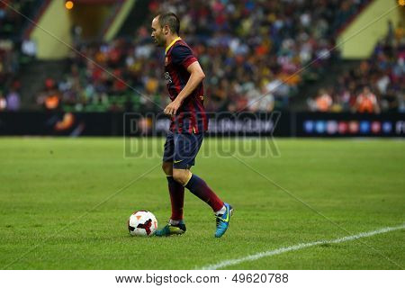 KUALA LUMPUR - AUGUST 10: FC Barcelona's Andres Iniesta controls the ball in a friendly match against Malaysian at the Shah Alam Stadium on August 10, 2013 in Malaysia. FC Barcelona wins 3-1.