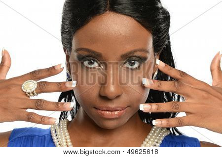 Young black woman's portrait wearing jewelry isolated on a white background