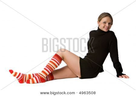 Smiling Girl Sits On The Floor