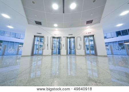 Four transparent elevator door in the business building