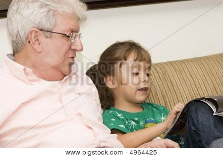 Grandfather Enjoying With His Granddaughter
