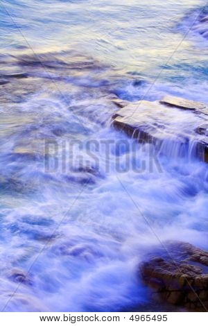 Wave Washing On Rocks