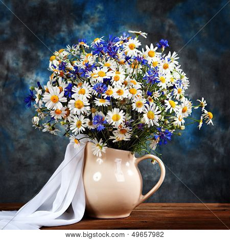 Chamomile And Cornflowers. Flowers In A Vase On The Table