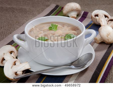 Delicious Soup With Mushrooms In A Bowl On The Table