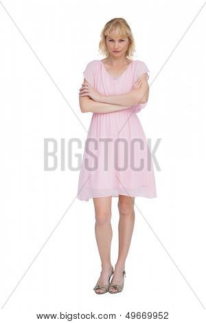 Reproachful blonde posing against white background