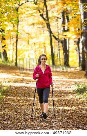 Nordic walking - active woman exercising outdoor