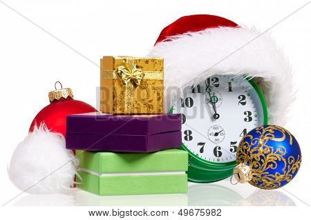 Alarm clock with christmas santa hat, isolated on white background