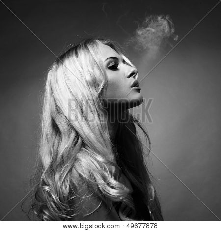 Fine art portrait of a beautiful lady smokes