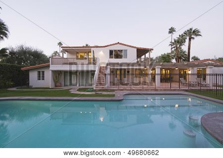 Swimming pool and modern home exterior against clear sky
