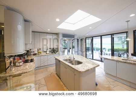 View of marble topped worktop units in modern kitchen at home
