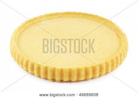Empty sponge cake flan case on white