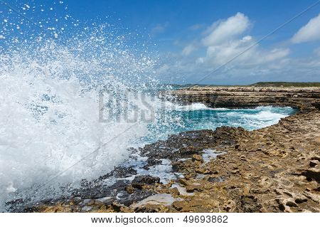 Waves Crashing Over Devil's Bridge Coastline Antigua