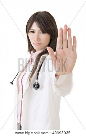Asian doctor give you reject gesture, closeup portrait on white background.
