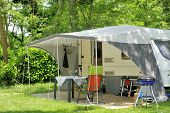 image of caravan  - Caravan with a awning at a camp site - JPG