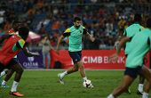 KUALA LUMPUR - AUGUST 9: FC Barcelona 's Gerard Pique dribbles the ball during training at the Bukit