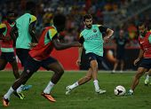 KUALA LUMPUR - AUGUST 9: FC Barcelona 's Gerard Pique controls the ball during training at the Bukit