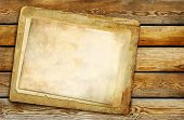 old blank papers over wooden background