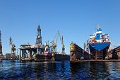 stock photo of shipyard  - Oil spill in shipyard  - JPG