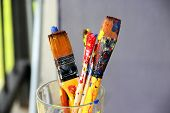stock photo of bute  - Mix of vivid paintbrushes stained with paints - JPG