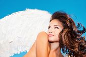 stock photo of blue angels  - beautiful angel woman with white wings against blue sky small amount of grain added - JPG