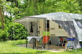picture of caravan  - Caravan with a awning at a camp site - JPG