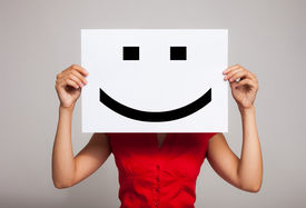 foto of emoticon  - Woman holding a smiling face emoticon - JPG