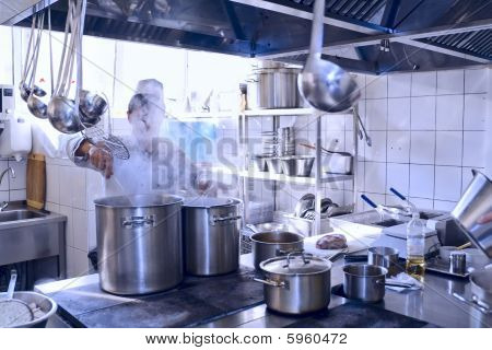 Chef Cooking At Commercial Kitchen