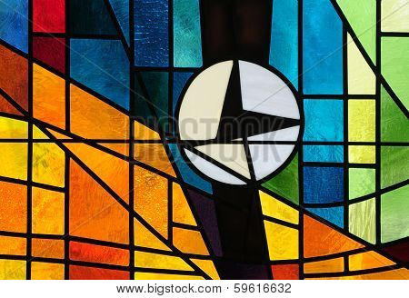 Stained glass window depicting a clock