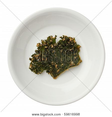 Roasted Kale Chips In A Bowl Isolated On White Background