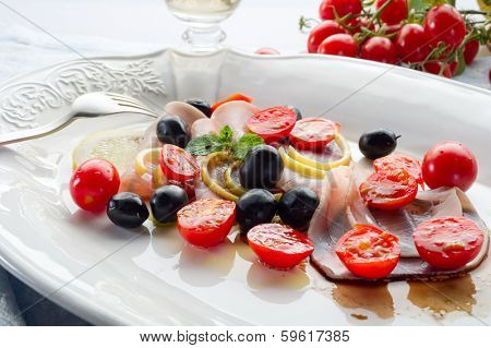 swordfish carpaccio with sliced tomatoes