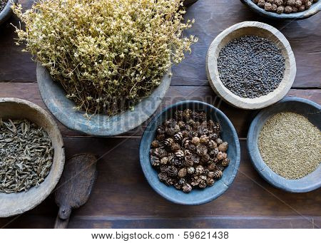 Herbs and spices in bowls used in ayurvedic medicine