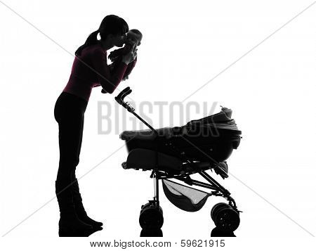 one caucasian woman prams holding baby kissing silhouette on white background