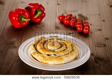 Spinach And Cheese Pie On White Plate