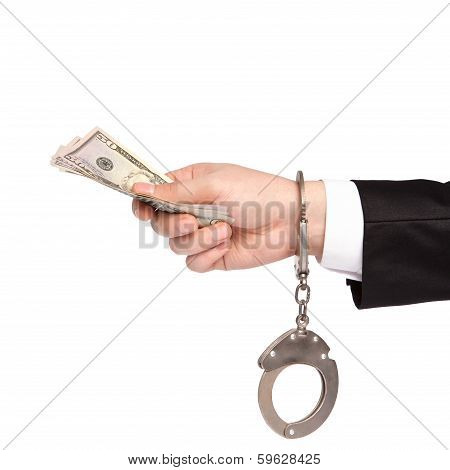 Isolated Hand Of A Businessman In A Handcuffs Takes Bribes Money