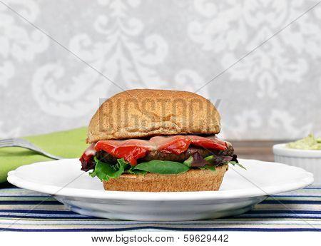 Portobello Mushroom Burger On A Whole Wheat Bun With Roasted Pepper And Provolone.