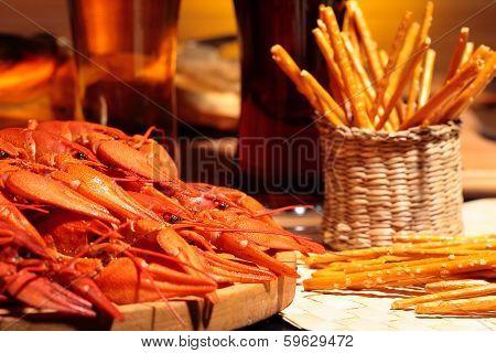 Prepared crawfish and glasses of beer