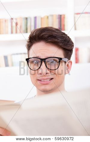 Stunned Student Surrounded By Books
