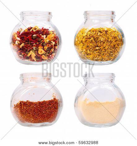 Various seasonings in glass jars  isolated