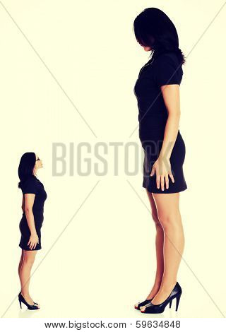 Businesswoman looking on her big version. Business growth concept.
